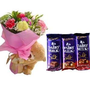 3 Cadburys Silk chocolates with 6 Inches teddy bear and 6 Carnations Bouquet
