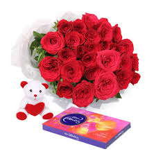 Cadburys celebration with 18 red roses and Teddy 6 Inches