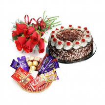 6 Red roses bouquet with 1/2 Kg black forest cake and small chocolate basket