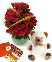1/2 kg Mix Mithai and 24 red roses basket with 10 inches Teddy