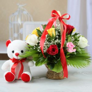 Teddy bear (6 inches) with 12 Mix roses in a Basket