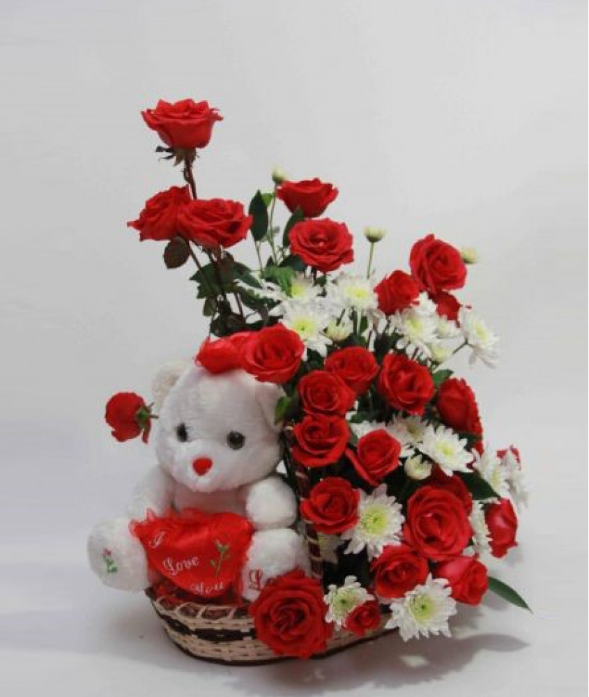 Teddy( 6 inches) in the same Basket with 18 Red�Roses and 6 white Gerberas