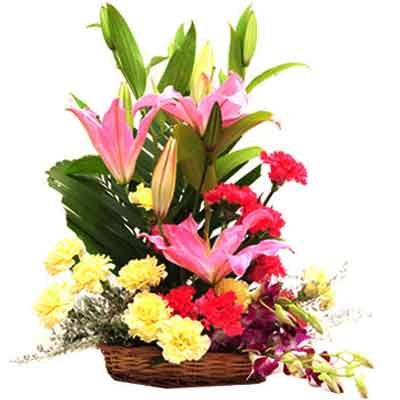 Pink Lilies pink and lemon carnations in a basket