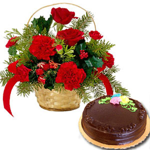 12 red Carnations in a basket with � Kg chocolate Cake
