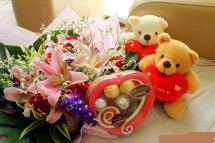 2 Teddy bears 6 inches each and pink Lilies in same basket with small heart chocolate box