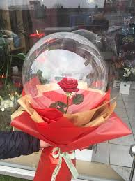 1 Red rose inside a transparent balloon with Red Wrapping