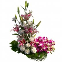 Basket of purple orchids and white carnations
