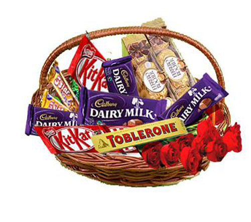 6 Red roses with Cadburys mix chocolates in a basket