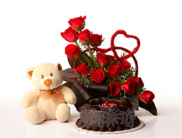 6 inches Teddy + 24 Red�Roses basket +1/2 kg Cake