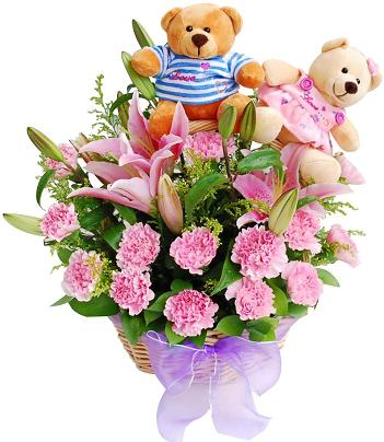 2 Teddies sitting in Basket with 18 pink carnations