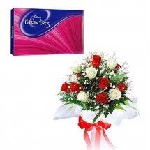 Cadburys celebration with 12 red and white roses bouquet