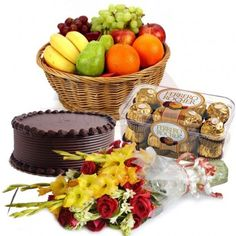 2 Kg. Fresh Fruits with 1/2 Kg Pineapple Cake and 12 Mix flowers 16 Ferrero