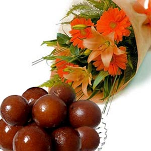 Liliums and Gerberas with 1/2 Kg Gulabjamun