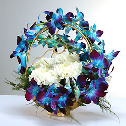 6 Blue Orchids on handle and 6 White Carnations in Basket
