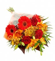 Orange and red flowers hand tied