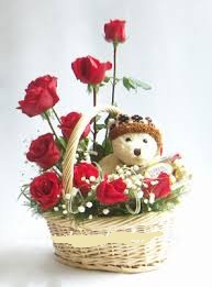 6 inches Teddy with 9 Red roses in same basket