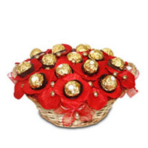16 ferrero with red wrapping arranged in a basket