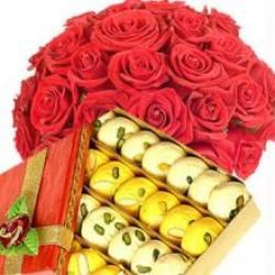 1 Kg Sweets and 12 Roses Basket