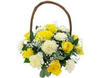 12 yellow white carnations in Basket
