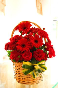 10 Red gerberas Basket