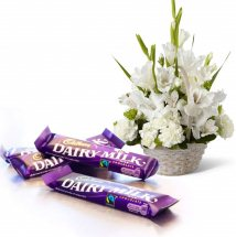 3 Dairy Milk chocolates and basket of 6 white gladiolli 6 white carnations