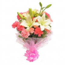 Pink carnations surrounding white Lilies