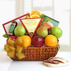 Fruit basket with cheese, chocolates, nuts, crackers