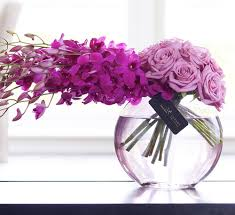 6 Purple Orchids 6 Pink Roses on either side of glass bowl