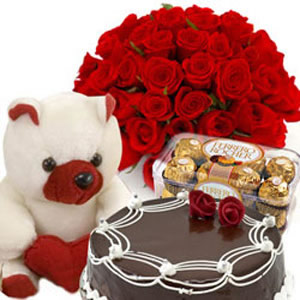 12 Red Roses+Teddy+16 Pieces Ferrero Rocher+1/2 Kg Cake