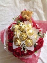 10 Red Roses with 5 ferrero and 1 teddy bear in same bouquet