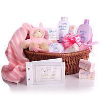 Baby Hamper consisiting of Oil,soap,shampoo,towel,socks, dress,diapers Pink teddy