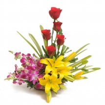 4 Purple Orchids 2 Yellow lilies 5 red roses in a basket