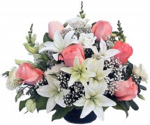 Pink roses white lilies in vase
