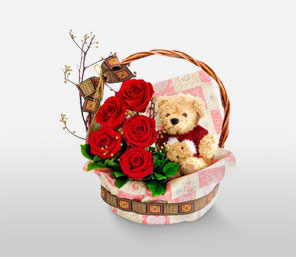 Teddy bear (6 inches) with 5 short stems of red roses in the same Basket