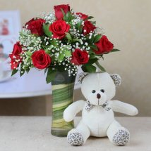 12 Red roses in vase with 6 inches Teddy
