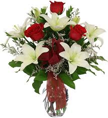 3 white Liliums 6 Red roses in Vase
