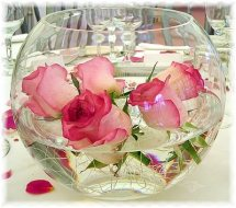 6 Pink Roses inside the glass bowl