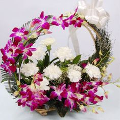 6 Purple Orchids on handle and 6 White Carnations in Basket