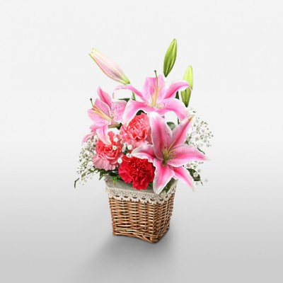3 Pink Lilies with 3 Pink Carnations in a basket