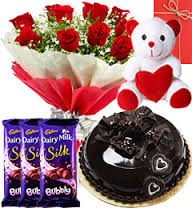 Teddy bear (6 inches) with 3 Bubbly Silk chocolates and 10 red roses bouquet 1/2 Kg chocolate cake