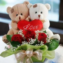 2 Teddy bears (6 inches each) with short stems of 3 red roses and 3 inch valentine heart in the same Basket