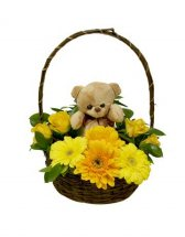 Teddy bear (6 inches) with 8 short stems of Yellow gerberas and yellow roses in the same Basket