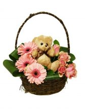 Teddy bear (6 inches) with 8 short stems of pink gerberas and pink roses in the same Basket