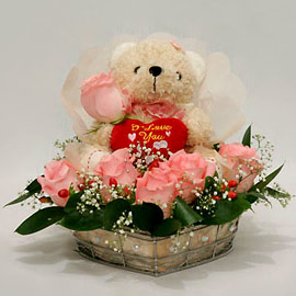 Teddy (6 inches) surrounded with 6 pink Roses