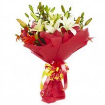 White Asiatic Lilies in red wrapping