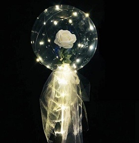 Trasparent balloon stuffed with one white rose with white wrapping and led lights