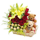 16 Ferrero rocher Chocolates and 2 Teddy bears 4 Yellow lilies 12 red roses in same basket