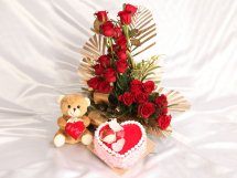 1 Kg Heart Black forest Cake with 20 red roses in a basket and 6 inches Teddy bear