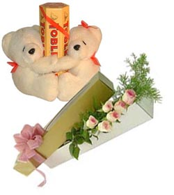 2 teddies with Toblerone chocolates and 6 pink roses