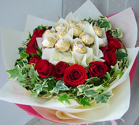 12 Red roses with 16 Ferrero chocolates in same bouquet